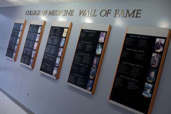 College of Medicine Wall of Fame plaques on wall